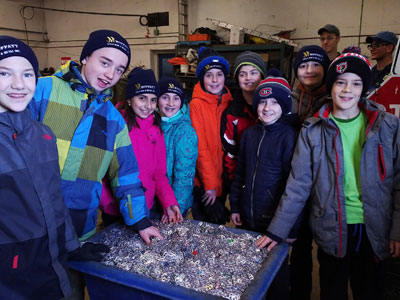 Stewarttown Public School students pose with the 200,000 pop can tabs collected over the last three years