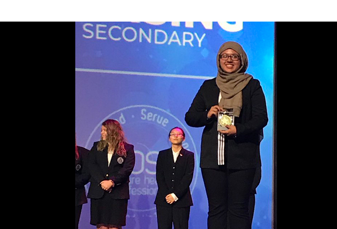 Areej, holding her FIRST PLACE award in clinical nursing at the HOSA International Leadership Conference in Florida