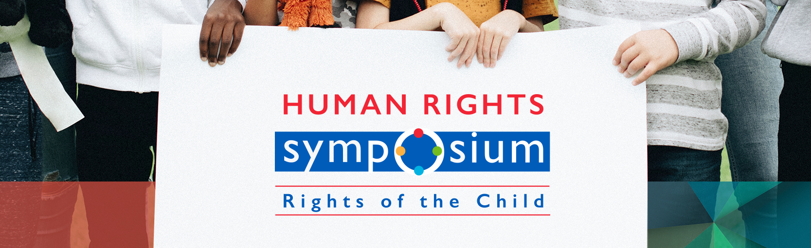 Children holding up a sign in a field with the Halton District School Board Human Rights Symposium logo